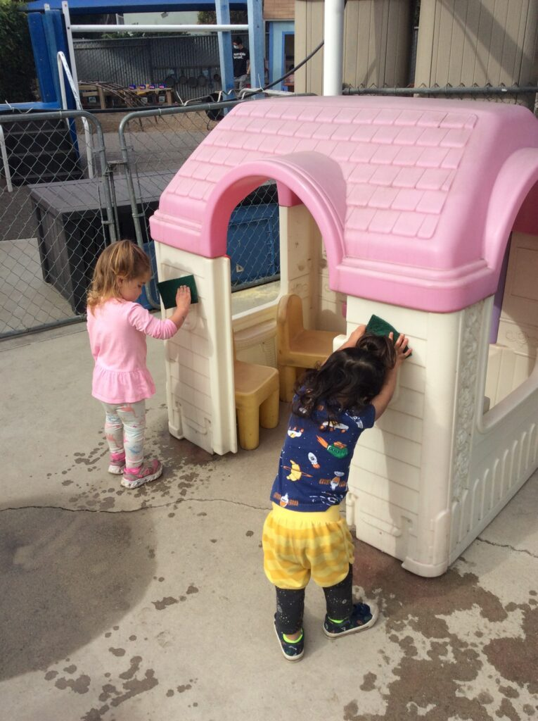 Toddler cleaning at preschool